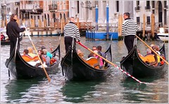 Gondolas in Venice (Ginas Pics) Tags: venice people italy woman man men wet water boat aqua stream italia ship stripes floating lagoon panasonic oar gondola palazzo venezia castello gondolier sanmarco vaporetto waterways waterreflection urbanlife traghetto riflesso dorsoduro sculling travelphotography canalegrande cannaregio ginaspics otw gondoliere sanpolo mywinners lumixaward canalasso felze canalegrande canalezzo santacroce venetiangondola