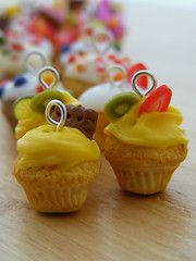 Cupcake Charms (Shay Aaron) Tags: christmas xmas party food orange holiday yellow happy miniature rainbow colorful handmade chocolate aaron cream fake mini jewelry charm whippedcream biscuit cupcake tiny pastry faux shay icing citrus scones lime muffin pendant frosting jewel petit               shayaaron wearablefood