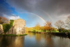 Rainbow over Wells (Stu Meech) Tags: autumn trees storm rain clouds dark shower rainbow nikon colours stu walk sigma wells somerset palace double bishops 1020mm polarizer moat hoya meech d40 2stop softgradnd