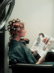 Susan at the Beauty Parlour in Curlers (drewleavy) Tags: woman london lamp beauty fashion lady magazine hair relax reading 60s waiting do sitting reader profile relaxing hairdo curls retro vogue heat hairdresser cape salon rollers academy chanel seated curley blowdry hairdressing madmen curlers blowdryer updo kisscurl beautyparlour pampering retrohairdo pamper headmasters artteam bettydraper frompariswithlove susanparkerleavy fashionhairdressing