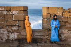 Sea and Sand (Patberg) Tags: travel morroco women sea fort ocean contrastingcolors orange blue