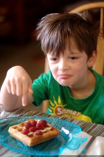 nick having raspberries on vegan sourdough waffles for breakfast - _MG_1784