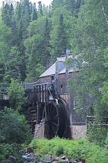 The Saw Mill (djking) Tags: blue red sky canada mill water wheel saw nb newbrunswick lumber kingslanding