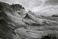 Quiraing, Isle of Skye, Scotland (welshio) Tags: travel winter wild sky blackandwhite bw cliff snow mountains film nature monochrome clouds landscape scotland highlands scenery isleofskye innerhebrides space north pass landmarks dramatic scottish panoramas stormy scene cliffs rockface scan hills lane views romantic bleak 4x5 remote isolation lonely wilderness peaks sublime drama picturesque crags cuillins lightshadow isolated largeformat zonesystem hebrides pictorial redfilter volcanicrock pushprocess cambo crag digg trotternish scottishhighlands 5x4camera windingroads naturallandscapes thequiraing blackcuillins largescale agfapan scottishlandscapes britishlandscapes ruggedlandscape mountainsociety ruggedlandscapes nopassingplace meanderingroads