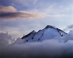 A mountain right where it belongs... in the sky (Zeb Andrews) Tags: sunset mountain color film landscape washington pacificnorthwest nationalparks mtbaker softlight northcascadesnationalpark pentax6x7 mountainpeak bluemooncamera zebandrewsphotography