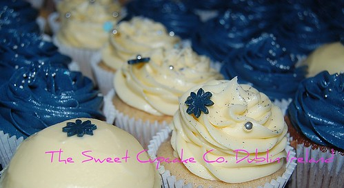 Navy and ivory cupcakes for a wedding