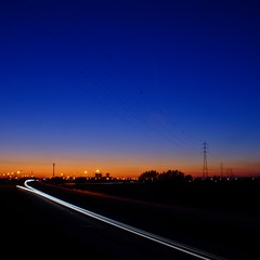 Sunset (Alesa Dam) Tags: longexposure blue sunset sky orange tree colors car silhouette point vanishingpoint twilight highway heaven glow power streak dusk trails powerlines trail gradient fv10 fading vanishing lightstreak starlight lighttrail gamewinner project365 challengewinner 167365 thechallengegame challengegamewinner