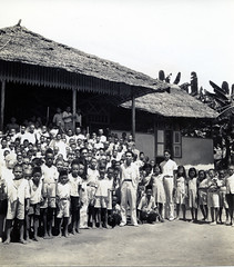 Teachers and children outside a school on Makian Island, Indonesia