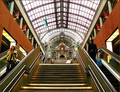 Escalator up, escalator down. (jackfre2 (on a trip-voyage-reis-reise)) Tags: roof ballet building clock glass station stairs dance belgium travellers central perspective railway landmark dome antwerp escalators platforms centralstation flanders thesoundofmusic abigfave mostbeautifulstationineurope