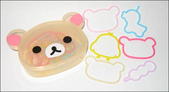 Korilakkuma Rubber Band (applel0ve) Tags: container dango 2009 rubberbands sanx korilakkuma kiiroitori kumashaped 18pieces fs94301 remotecontrolduck