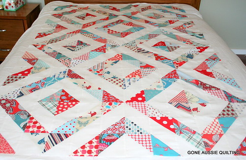 Red and Aqua Half Square Triangle Quilt by heidigoneaussie