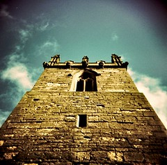 """""""Well, the bells out in the church tower chime/Burning clues into this heart of mine"""" (The James Kendall) Tags: old blue sky tower church window yellow stone holga xpro worship mum provia vingette crossproccess nortondisney cagefightregret3"""