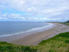 Rhossili Beach (Tasmin_Bahia) Tags: blue sea summer sky sun colour detail green beach nature water clouds outside outdoors sand pretty peace bright peaceful sunny cliffs colourful simple rhossilibeach tasminbahia