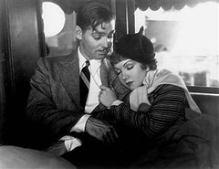 Paul (Clark Gable) watches Ellen (Claudette Colbert) sleep