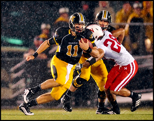 Missouri sophomore quarterback Blaine Gabbert runs the ball against Nebraska junior safety Eric Hagg during the first play of the game.