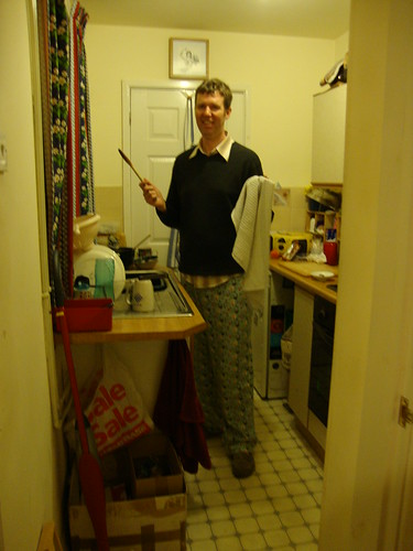 Pete making dinner in his kitchen while wearing squirrel pj bottoms