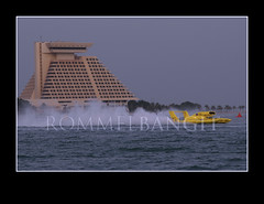 Peter and May hydroplane speeding in front of Sheraton Hotel Doha by the Corniche Bay in Doha Qatar during the H1 Unlimited Oryx Cup November 20, 2009.  Hydroplane Race for the first Oryx Cup 2009. Photographer  ROMMELBANGIT (ROMMEL BANGIT) Tags: building architecture abra hull watersports marinesports 2009 hydroplane samcole sheratonhotel roostertail boatracing fourseasonhotel hydroplaneracing mikewebster thunderboat grahamtrucking davevillwock formulaboatscom stevedavid ohboyoberto jeantheoret sheratonpark brianperkins jeffbernard natebrown alcorniche dohabay gofastturnleft missmadison qatararchitecture rommelbangit greghopp ourgangracing qatarskyline qatarsports jmichaelkelly sportrace ellstromelamplus qmsf oryxcup2009 oryxcup h1unlimited matrixsystemautomotivefinishes superiorracing misspetersmayracing lelandunlimited kenmuscatel cindyshirley lycomingt55l7turbine jetafuel dohasports dohawaterfront oryxcuphydroplaneracing h1unlimitedoryxcup2009