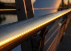 lines. (gardinergirl) Tags: bridge light summer orange sunlight toronto water metal sunrise dawn bokeh railing lakeontario 18200mm humberbaybridge