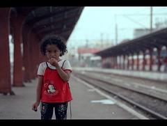 That Curly-haired Little Girl (khaniv13) Tags: portrait cute film girl station train hair waiting little shy curly jakarta passenger stasiun nikonfe kota fujinps160 100mmf28seriese khaniv13