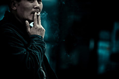 Almost anonymous (ArTeTeTrA) Tags: street blue portrait man face hand bokeh blu cigarette smoke smoking mano stolen ritratto