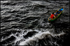 Lone Oarsman (Abhisek Sarda) Tags: ocean sea india man water boat waves alone