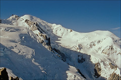 mont blanc and dome de gouter (Ron Layters) Tags: white mountain snow france mountains alps ice geotagged pentax slide bluesky glacier transparency chamonix montblanc hautesavoie pentaxmz10 agfachrome mountainsalps elevation40004500m summitmontblanc elevation45005000m altitude4807m domedegouter montmaudit ronlayters slidefilmthenscanned massifdumontblanc mz10 geo:lat=45833611 geo:lon=6865 highestmountainineurope