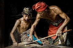 Badung, Bali - Father and son blacksmiths (Mio Cade) Tags: travel boy shirtless bali man metal indonesia fire photography iron father son master heat sweat sword kris tradition endurance ubud alloy skill knive pande badung alemdagqualityonlyclub masterofmetal thisiscalledphotograph committeeofartistists