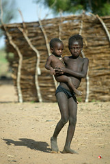 Girl Carrying Child