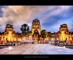 Angkor Wat Lights Up :: HDR (Artie | Photography :: I'm a lazy boy :)) Tags: reflection building classic water stone architecture night photoshop canon temple ancient sandstone bravo cambodia khmer state cs2 dusk tripod wideangle angkorwat structure symmetry 1020mm siemreap hdr artie angkorvat 12thcentury 3xp sigmalens photomatix tonemapping tonemap 400d rebelxti suryavaman