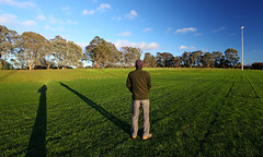 Looking at Morning Moon - Dickson District Playing Fields, Canberra. (Clement Tang ** Busy **) Tags: morning travel moon selfportrait nature skyscape landscape spring australia bluesky canberra lunar nationalgeographic longshadows concordians dicksondistrict dicksonplayingfields