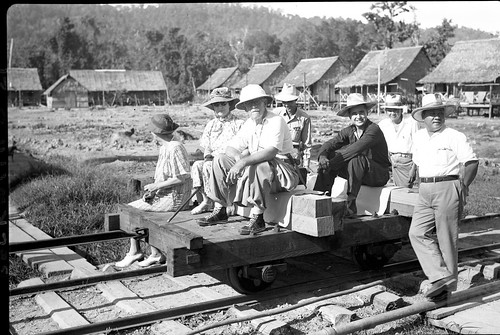 Group on tram in lumber camp