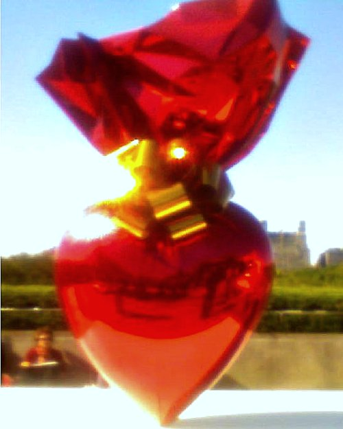 This is a dark, grainy, and out-of-focus photo of a Jeff Koons sculpture on the top of the MOMA in New York. It was wicked, and no, the picture does not do it justice.