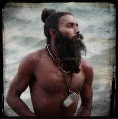 India's Cellphone Revolution (designldg) Tags: travel portrait people india man male heritage water river square peace phone expression religion handsome atmosphere panasonic human soul ethereal varanasi nudity spiritual shanti hindu hinduism kashi lightness ganga sadhu ganges ghats benaras uttarpradesh  corporeal indiasong dmcfz18