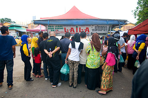 Buying food to go at an evening market on the eve of Aidilfitri, Kota Bharu, Malaysia
