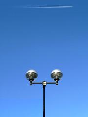 a vision of angels (friendlydrag0n) Tags: street blue light sky lamp globe contrail post minimal trail condensation minimalism minimalist con vapour vapor vapourtrail vaportrail luminair