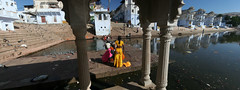 Varaha Ghat, Brahma Kund : Pushkar, Rajasthan India (India.Stretched) Tags: india lake reflection yellow architecture evening arch tank religion pillar steps holy sacred devotees pushkar hindu saree pilgrimage rajasthan whitewash pilgrims brahmakund abllution varahaghat