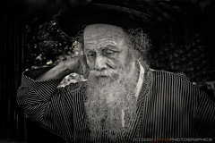 P1040846 (digital_don) Tags: portrait bw man hat beard washingtondc rally streetportrait panasonic elderly jew orthodox draganizer dmcgf1 2011 antiaipac