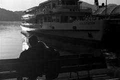 ghosts of saturday night iii/viii (The Cassandra Project) Tags: bw film monochrome trash 35mm vintage schweiz switzerland junk suiza swiss luzern tokina litter diafine sw ghosts detritus expired svizzera littering sundaymorning lucerne mll apx vierwaldstttersee gegenlicht abfall morgensonne nikonf90x lakelucerne sveitsi agfaapx100 kkl europaplatz rolleiretro100 kleinbild tokinaatxproliebeloveloversumschlungenembrace2870