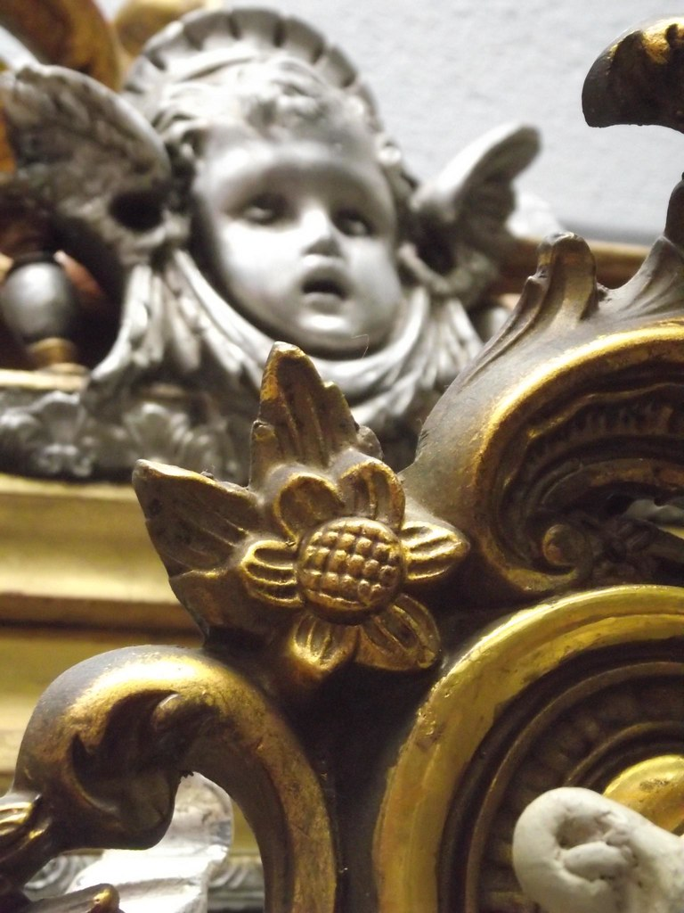 french antique gilded mirror with silver cherub face