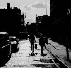 the long journey home (Ian Brumpton) Tags: street city uk england people urban blackandwhite bw black london blancoynegro skyline square blackwhite couple strada britain pavement candid citylife streetphotography couples explore sidewalk squareformat angleterre rue bricklane streetphotographs streetphotographer streetcandid panasoniclumix explored blackwhitephotos platinumheartaward dmclx3 scattidistrada stryker66