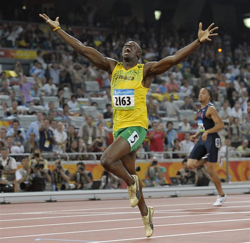 jamaica_s_usain_bolt_celebrates_as_he_wins_the_men_48ac6ae2be