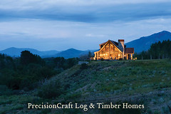 Exterior View at Twilight | Custom Handcrafted Log Home | PrecisionCraft Log Homes (PrecisionCraft Log & Timber Homes) Tags: pictures wood homes house mountain home design log cabin floor plan handcrafted custom architects luxury precisioncraft