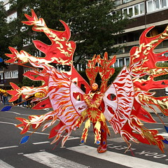Burning Up (@richlewis) Tags: street red portrait england london canon eos gold dance costume mask candid flames dancer parade nottinghill sigma30mmf14exdchsm 450d nottinghillcarnival2009