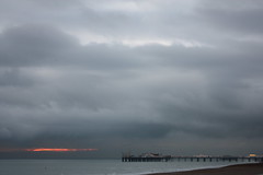 Sun Set at Brighton Pier (thejollyroger) Tags: sunset sea sun rain set dark sussex pier brighton place east seafront eastsussex palacepier cloundy