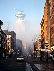 gm_10239 Harbour Centre Construction Fog, Gastown Vancouver 1977 (CanadaGood) Tags: bc britishcolumbia vancouver gastown analog 1977 construction crane harbourcentre fog traffic slidefilm downtown kodachrome slidecube red blue colour color sign parking tree morning streetphoto building canadagood canada best favourite seventies text