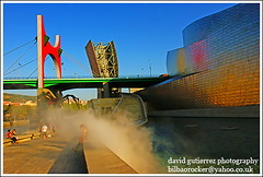Guggenheim Museum Bilbao - Smoke on the Water (david gutierrez [ www.davidgutierrez.co.uk ]) Tags: city urban building art water colors museum architecture modern buildings spectacular geotagged photography design photo spain arquitectura cityscape image smoke sony centre cities cityscapes center front structure architectural bilbao explore 350 page architektur sensational guggenheim metropolis alpha frontpage impressive dt ghery municipality edifice cites guggenheimbilbao f4556 smokeonthewater 1118mm sonyalphadt1118mmf4556 sony350dslra350
