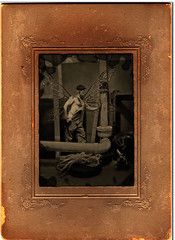 Plumbing Fairy (IMAllen) Tags: hairy male sepia photoshop wings antique chest pipes basement cigar rope dirty fairy cap frame overalls worker plumber gears ruler steampunk