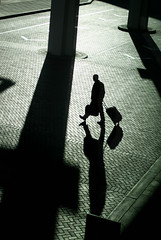 Always Going Somewhere (Universal Stopping Point) Tags: shadow silhouette bag walking evening airport texas houston footsteps stretched posts suitcase carryon traveler longcastshadows contrastedbrightenedvibrancyuppedslightcrop