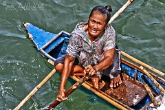 The Boat Woman (Lenareh) Tags: life sea people woman boat seagypsies badjao indigenoustribe badjaos pinoykodakero lenareh manoftheseas