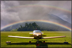 Fly to the rainbow (*Lie ... on a short break ... !) Tags: regenboog switzerland rainbow nikon colours airshow 1001nights darkclouds kleuren samedan sanktmoritz strangeeffect aftertheshower aplusphoto flickrdiamond platinumheartaward engiadinaclassics nikonflickraward nikonflickrawardgold eigenaardig platinumbestshot naderegenbui nognetoptijd